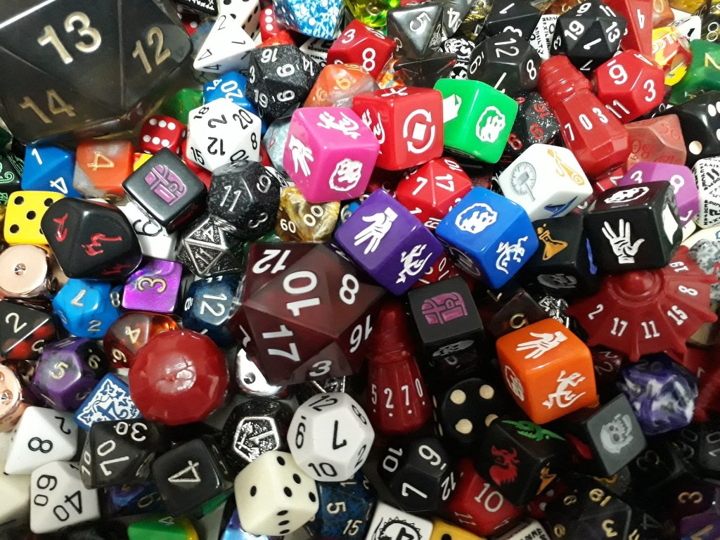 a pile of multi-coloured and multi-sided dice